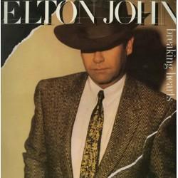 Elton John – Breaking...